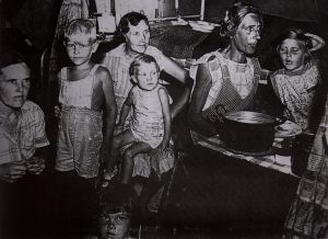 Half-starved women and children in one of the Dutch East Indies camps
